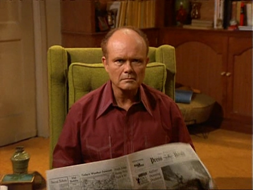 Red Forman reading a news paper