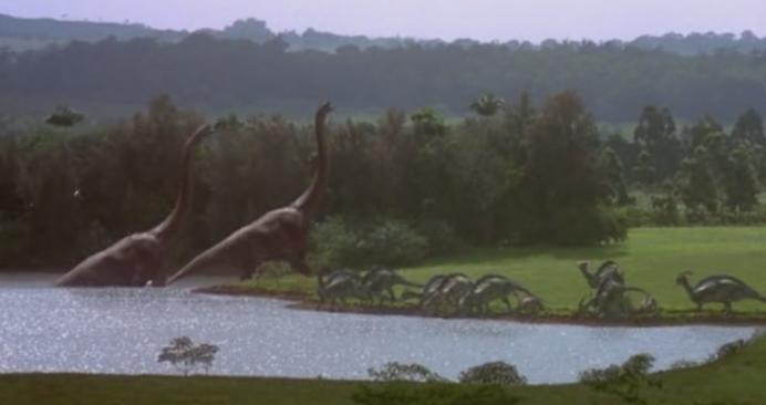 Dinosaurs in a field and lake from Jurassic Park