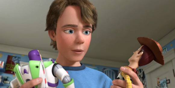 Andy holding Buzz Lightyear and Woody in Toy Story 3