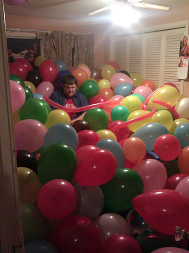 Walnut in a room full of balloons.