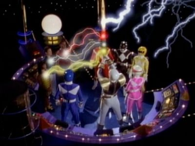 Tommy transferring the power of Red, Yellow, and Black rangers to Rocky, Adam, and Aisha